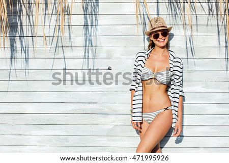young sexy woman wearing hat ...