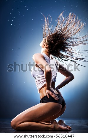 Young sexy woman with fluttering hair. Water studio photo.