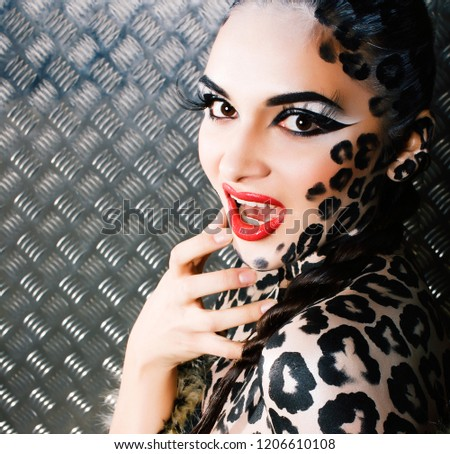 4bebd3c50 young sexy woman with leopard make up all over body, cat bodyart #1206610108