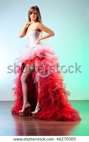 Young sexy woman with red dress. - stock photo