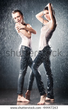 Young sexy women. Water studio photo. - stock photo