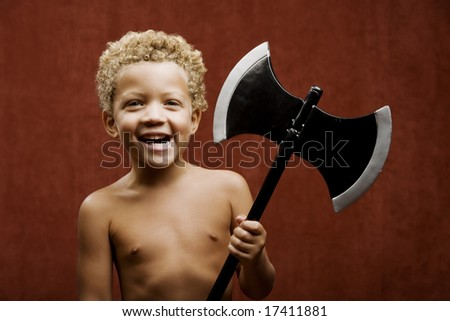 Young shirtless boy with a toy hatchet