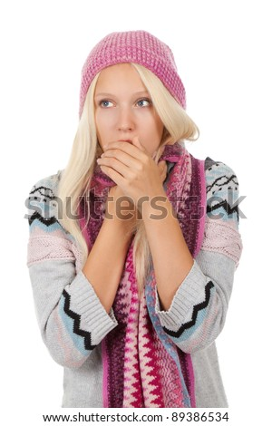 young sick girl got flu or cold, cover mouth by hold hand, wear wear winter knitted pink hat scarf and sweater, isolated over white background