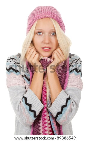 young sick girl got flu or cold, hold hand on neck, throat, wear wear winter knitted pink hat scarf and sweater, isolated over white background