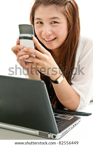 Young Sister searching internet and Chatting with her friend in network internet.