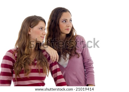 young sisters looking sideways on an isolated background