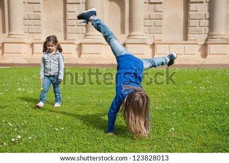 Young sisters playing outdoors.