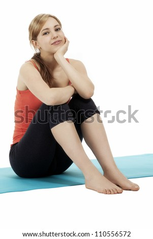 young sitting cute blonde fitness woman on white background
