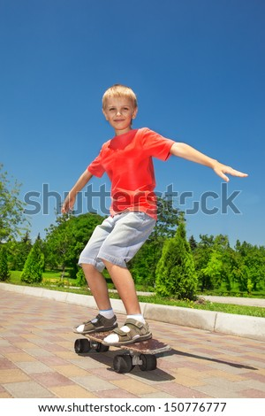 Young skateboarding learner in a park