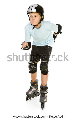 Young skater boy ready to ride on roller skates. He's looking at something. Front view. Isolated on white background.