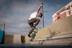 young skater makes a jump in a skate park