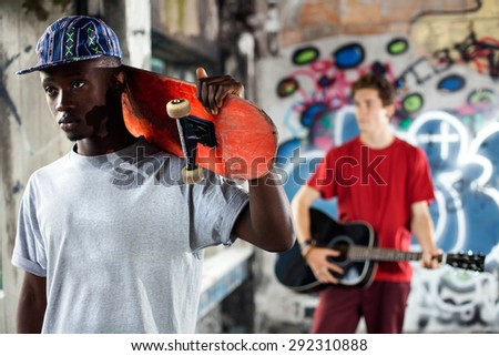 Young skater ready to show his skills in an urban place