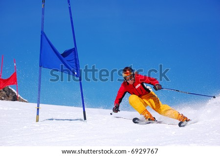 Young ski racer doing downhill slalom