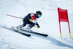 young skier in action in slalom ski competition slalom downhill