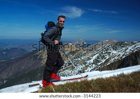 Young skier relaxing on mountain