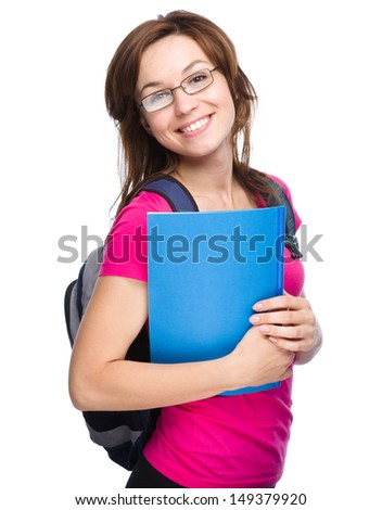 Young skinny student girl is holding exercise book, isolated over white