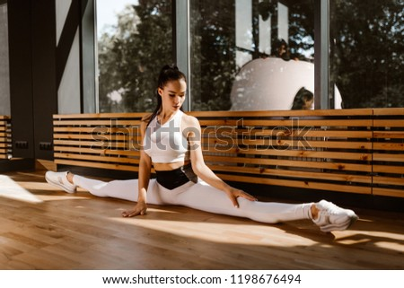 Woman doing stretching. Do the splits. Slender young woman doing ...