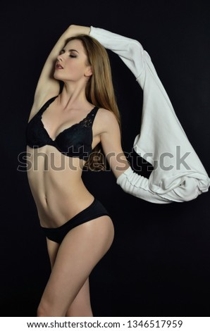 Almost nude young girl the same