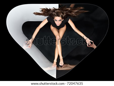 Young slim beautiful lady with long hairs running in abstract plastic tube, ring flash fashion portrait