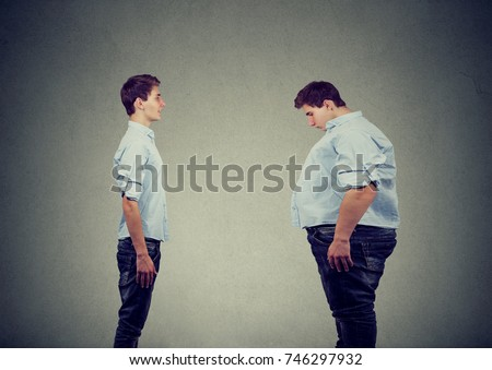 Young slim fit man looking at fat himself. Diet choice right nutrition healthy lifestyle concept Photo stock ©