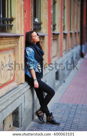 Young Trendy Woman Leaning Against A Wall Images And Stock