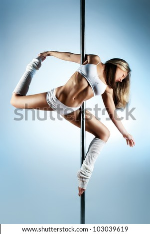 Young slim pole dance woman. - stock photo