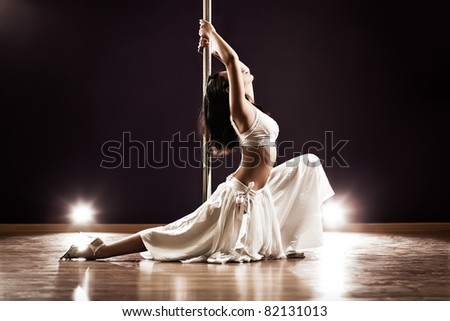 Young slim pole dance woman. Contrast colors.