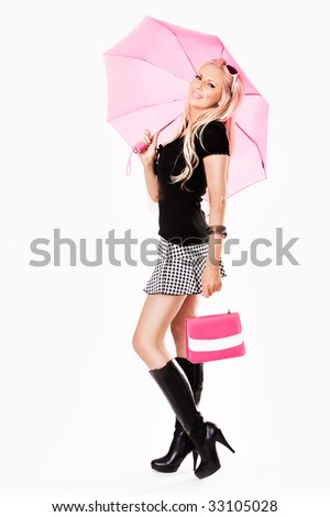 stock photo : Young slim sexy pin-up woman in leather boots and short skirt
