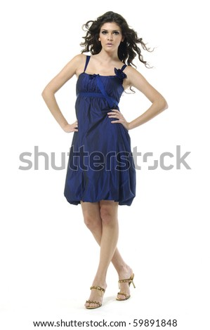 Young slim woman in blue dress. Isolated on white