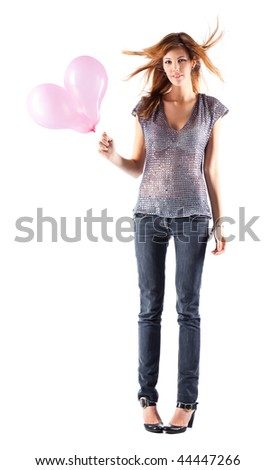 Young slim woman with balloons. Isolated on white.