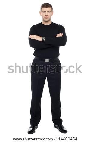 Young smart bouncer posing with his arms crossed isolated over white background.