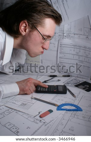 Young smart scientist working in office at night