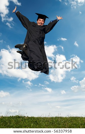 Young smiley graduate student in gown jumping over blue sky