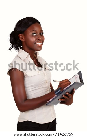 young smiling African American businesswoman wearing light shirt with a diary