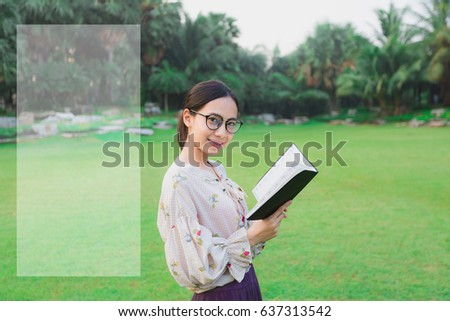Young smiling asian woman is reading diary book garden, happy learning, self learning