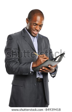Young smiling black businessman taking notes isolated on a white background