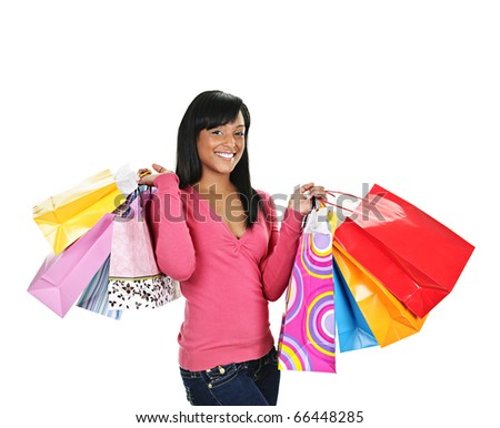 Young smiling black woman holding colorful shopping bags