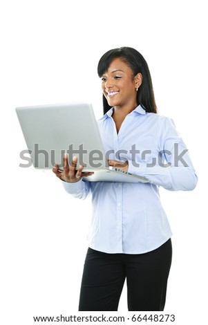 Young smiling  black woman standing with laptop computer
