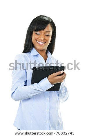 Young smiling black woman using tablet computer
