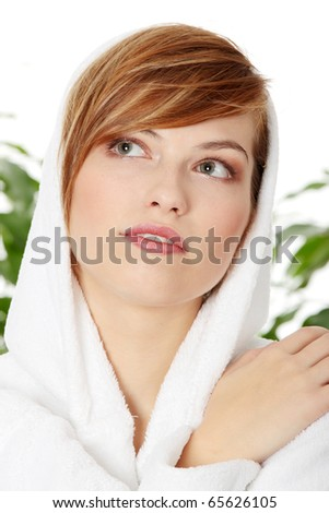 stock photo : Young smiling blond teen woman wearing bathrobe. Green leafs ...