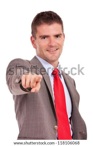 young smiling business man pointing and looking at the camera on white background