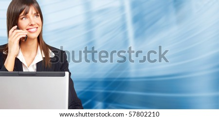 Young smiling  business woman with laptop and cellular