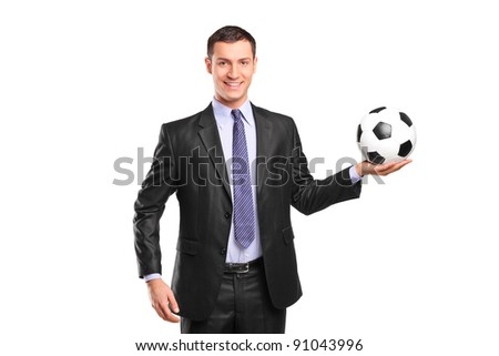 Young smiling businessman holding a football isolated on white background