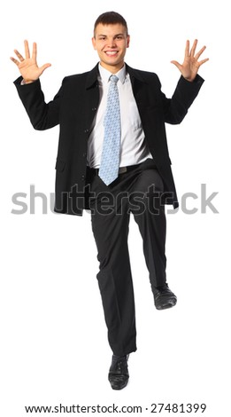 young smiling businessman jumps