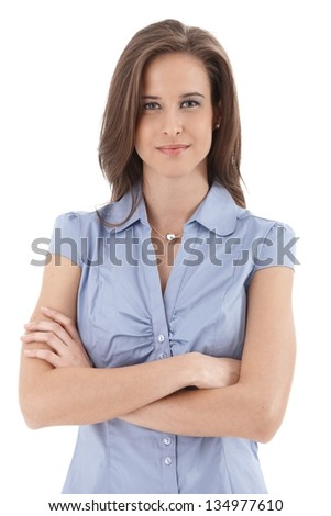 Young smiling businesswoman portrait, standing with arms folded, isolated on white.