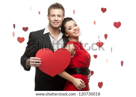 young smiling caucasian couple holding sign in form of red heart isolated on white background