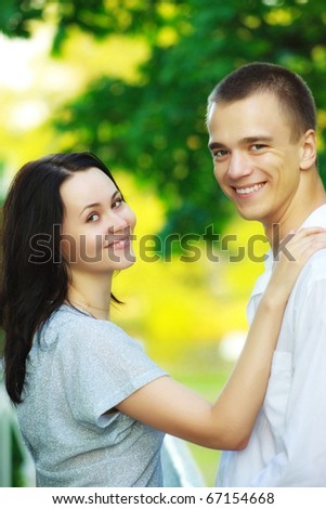 young smiling couple in summer park