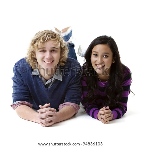 young smiling couple lying side by side