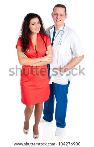 Young smiling couple of handsome man doctor and pretty nurse in blue, white and tangerine tango uniforms, looking at camera. Full body image, isolated on white background. Healthcare concept series.