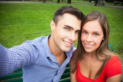 Young smiling couple taking a selfie portrait
